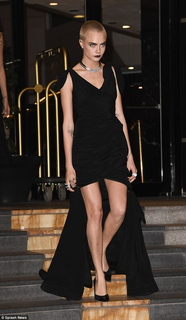 Gothic glamour: Cara certainly made a strong impression thanks to her dramatic dress