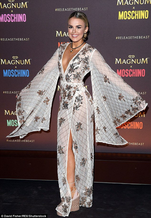 Like A Bat Wing Outta Hell: Keen to display every aspect of the stunning look, she raised her arms in the air and displayed the bat wing sleeves on the outfit which gave further drama to the look