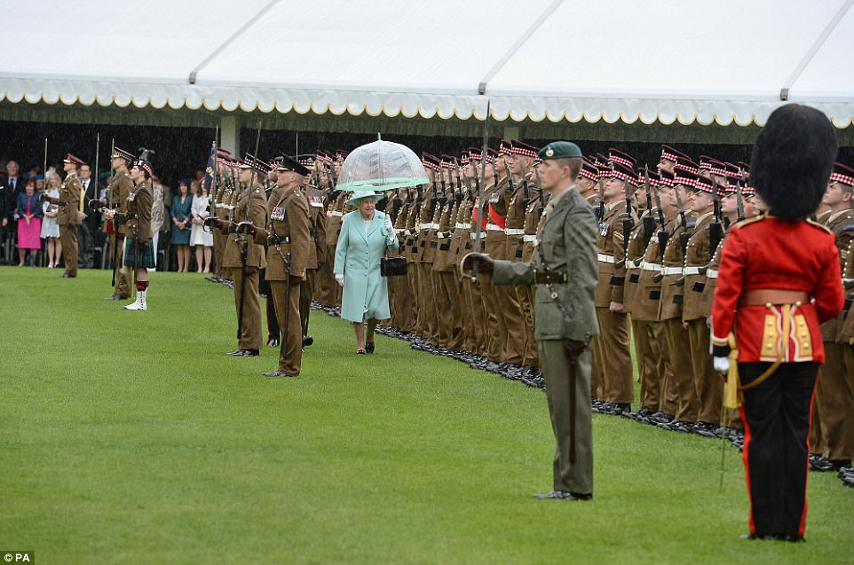 The regiment were dressed in red bear skins and khaki uniform to receive their honour on Thursday