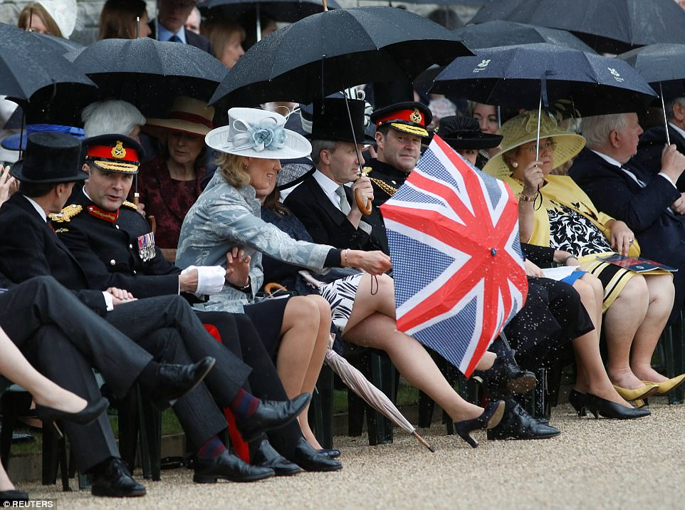 The Queen welcomed 2,200 guests to Buckingham Palace on Friday, with the majority equipped with umbrellas