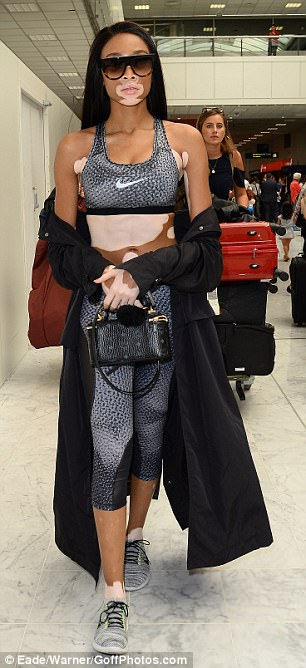 Sweat it out: Clinging to her hips and perky derriere, the Canadian beauty wrapped a dramatic black duster coat around her frame while she made her way to her waiting car
