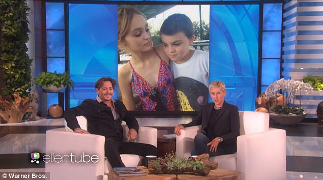 Proud father: The 53-year-old actor glowed as he was shown a photo of Lily and his son Jack, 15
