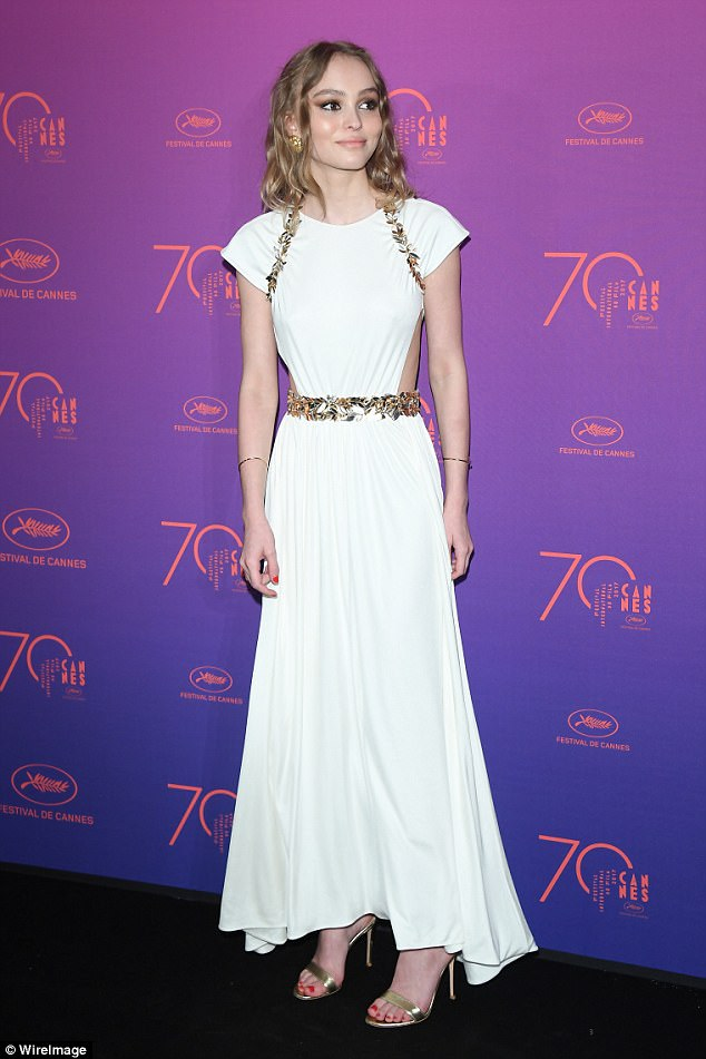 Grecian goddess: His daughter Lily-Rose Depp posed at theOpening Gala dinner during the 70th annual Cannes Film Festival at Palais des Festivals in France on Wednesday