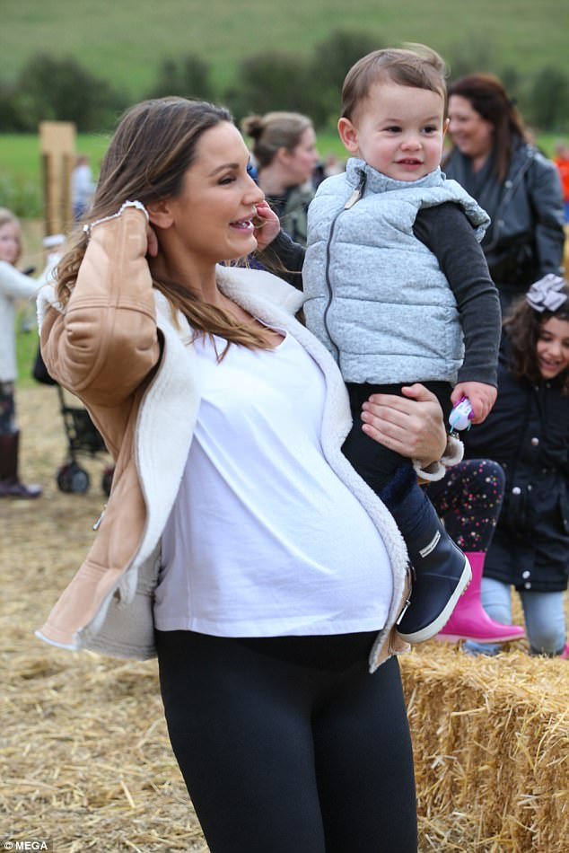 Beauty: Sam Faiers, 26, was seen positively glowing as she showcased her blossoming baby bump during a family outing to a Pumpkin Farm in St Albans on Tuesday
