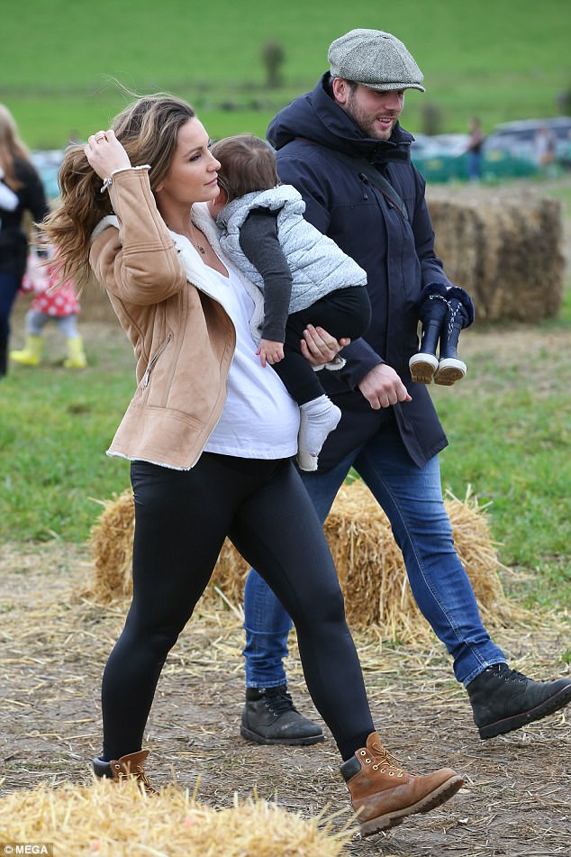 Family outing: She was joined by boyfriend Paul and their cute one-year-old son, also named Paul, as they picked out pumpkins together for Halloween