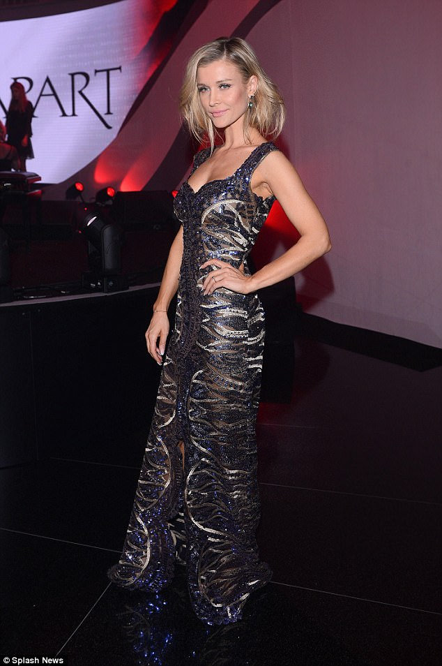 Wow: Joanna Krupa slipped on a glamorous dress for a party in Warsaw, Poland on Monday