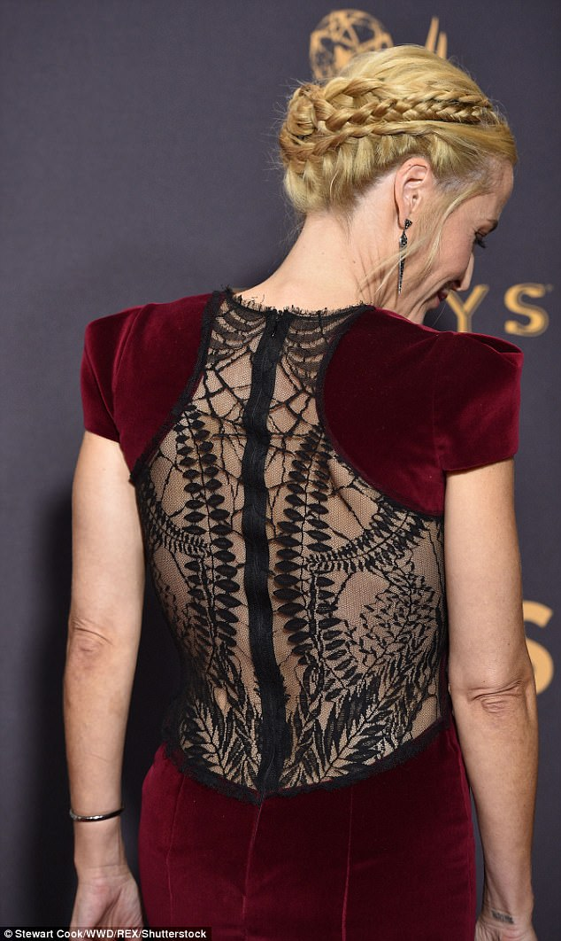 Give us a twirl: The back of the frock was laced and sheer, with a black intricate detailing, teasing the star's complexion underneath