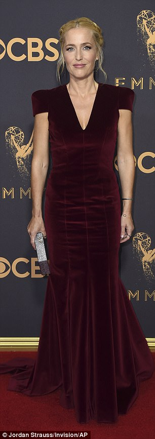 It's all in the details: Gillian Anderson, 49, looked beautiful in her burgundy gown; the frock had delicate lacing in the back