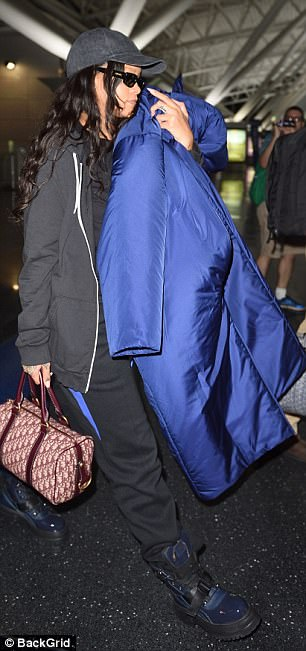 How to accessorise: The Valerian and the City of a Thousand Planets actress didn't skimp on her handbag as she toted a burgundy handbag, brimming with her essentials