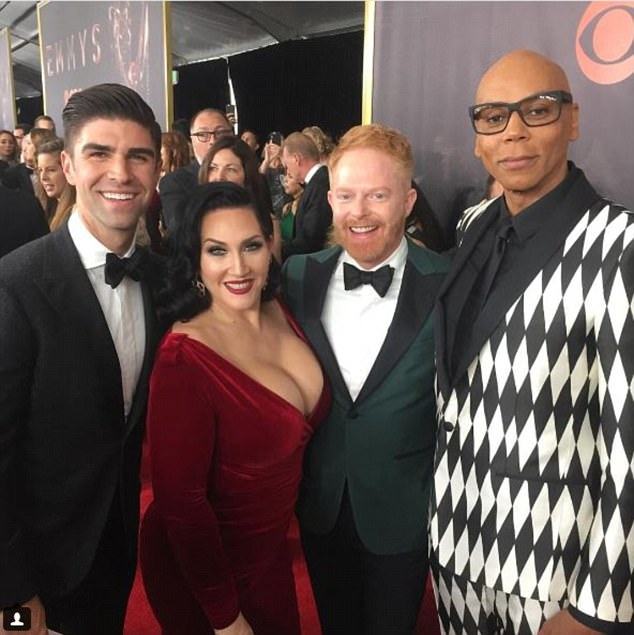 All smiles: Another snap-happy member of the cast was Jesse Tyler Ferguson - who plays Mitchell Pritchett on the ABC sitcom - posting a number of candid photos from the red carpet (Pictured L-R with his husband Justin alongside Michelle Visage and RuPaul)