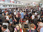 Travellers should brace themselves for lengthy queues at Sydney Domestic and International Airport this weekend (stock image)
