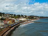 A trial at Exeter Crown Court heard how two 14-year-old girls had lied to their parents about having a sleepover and instead gone to a friend's sister's flat on the Dawlish seafront (pictured) in Devon. It was there that Lee Pollard and Mark Allen, both 26, plied them with drink and drugs before having sex with them