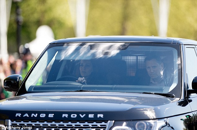 Driving duchess: Some even cheered when they saw the Range Rover going through and onto the palace forecourt – although it is not clear whether the tourists had actually spotted her inside