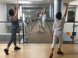 Violinist Anthony Hyatt leads dancers through MedStar Georgetown University Hospital in Washington on Oct. 11, 2017. Musicians and dancers are part of the Georgetown Lombardi Comprehensive Cancer Center's arts and humanities program. (AP Photo/Tom Sampson)