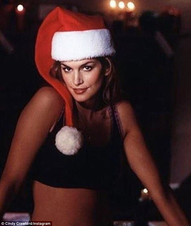Mrs. Claus? Cindy Crawford posed in a Santa hat and a skimpy crop top as she shared festive throwbacks from 1992 Bon Jovi music video Please Come Home For Christmas on Thursday