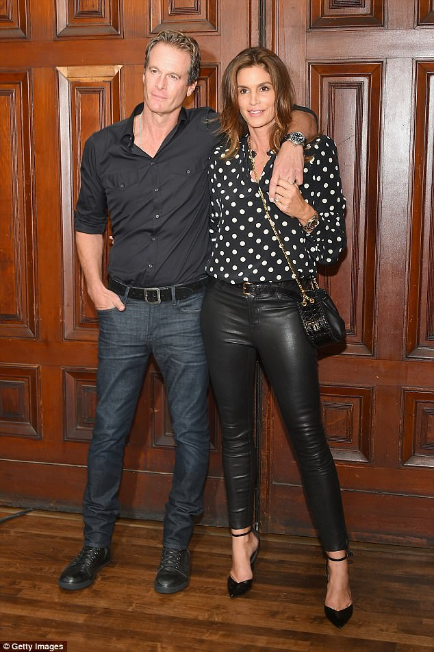 In real life: Although Jon and Cindy looked like a picture-perfect couple, she has been married to male model turned businessman Rande Gerber for almost 20 years (pictured in September)