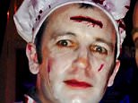 Neville Hord, 44, was pictured wide-eyed and covered in fake blood as part of a fancy dress costume for Halloween