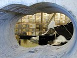 Brett Afshar says the crooks who drilled this half-metre hole gave Hatton Garden the best advertising campaign it's ever had