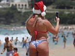 Beach bum: People were enjoying the sun at Bondi on Sunday morning
