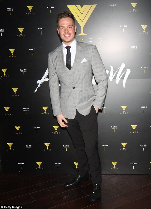 Suited and booted: Capital FM DJ James Hall went for a more demure look for the night out, as he arrived in the club in a sleek grey and black suit