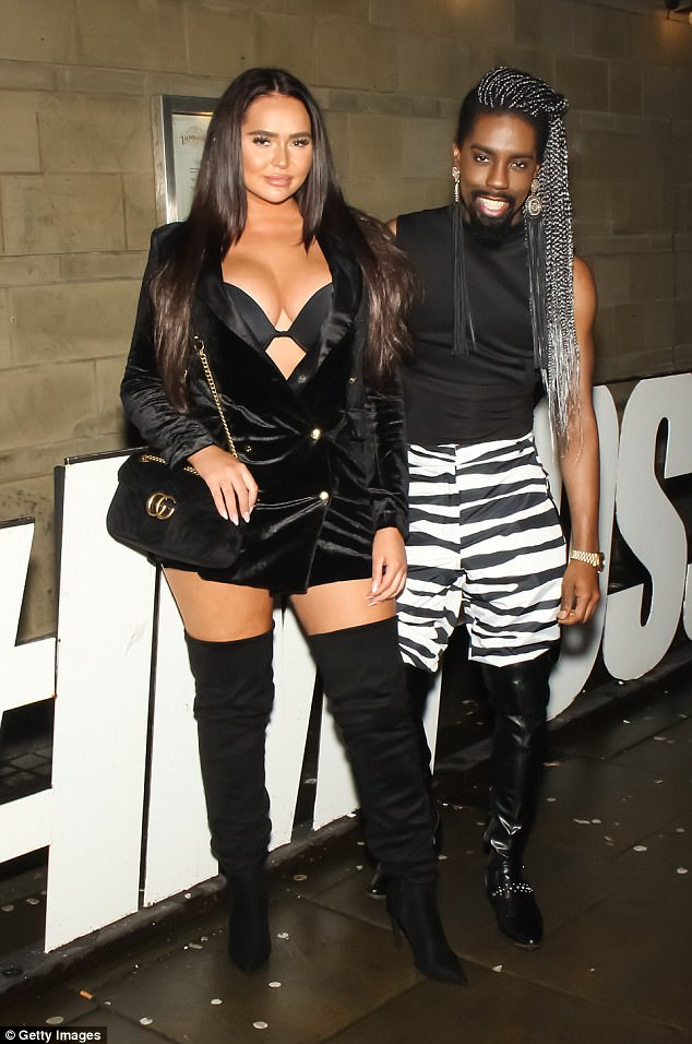 Hmm: The reality stars then went to war on Twitter - with Jemma branding Chanelle the 'dregs of Manchester', while Chanelle hit back that her rival was 'nothing more than a bully'. Pictured with fashionista JSky, 30, at the event