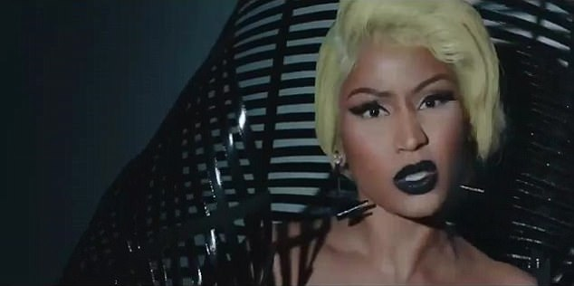 Distinctive! Nicki also pushed the boundaries with some vibrant yellow hair, severe dark lipstick and very long lashes