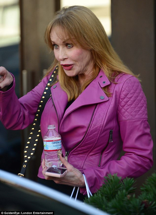 Svelte figure: The actress showed off her trim physique in a fuchsia biker jacket, which featured quilted paneling