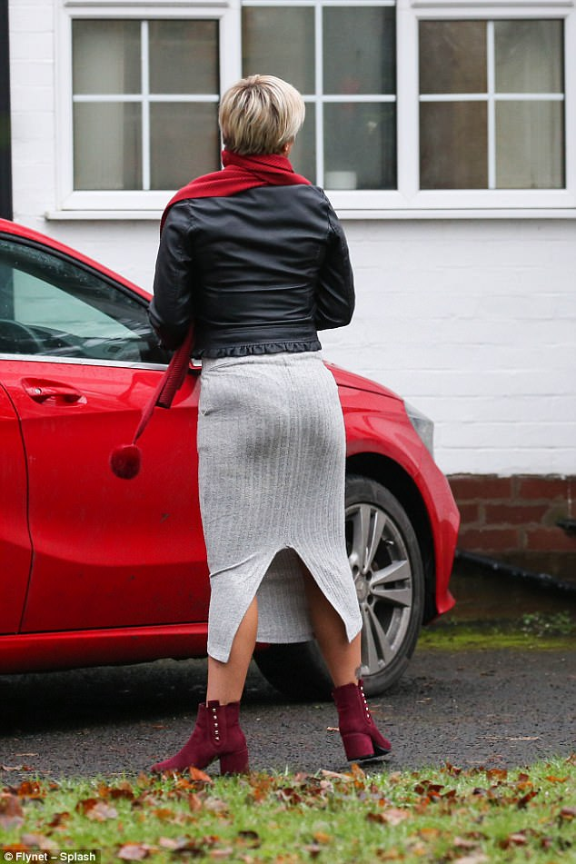 Slim physique: The former Atomic Kitten singer showed off her svelte figure in a ribbed grey midi-skirt which featured a slit at the back