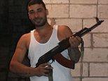 Disturbing: Pictures show 29-year-old murder suspect Tarek Hawchieh proudly posing with a Klashnekov gun