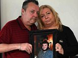 Sheena and Colin Hill with a photo of their son Dean, 24, who they found dead in his bed on Christmas Eve in Washington, Sunderland