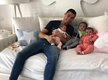 Cristiano Ronaldo posted an Instagram photo with three of his youngest children, captioning it 'I'm a prisoner of these babies' after a tax boss said he should be in jail