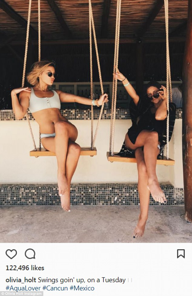 No care in the world: Olivia also rocked a button up neutral bikini top and matching bottoms for another snap, this time on a wooden swing with a friend