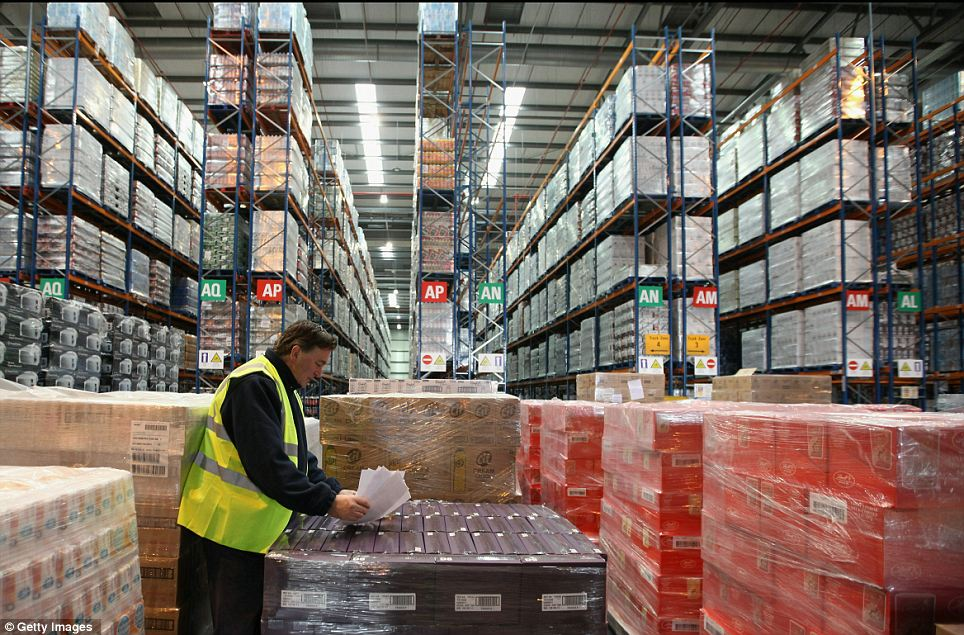 Gigantic: A Sainsbury's worker checks pallets as the store's Christmas rush gets nearer