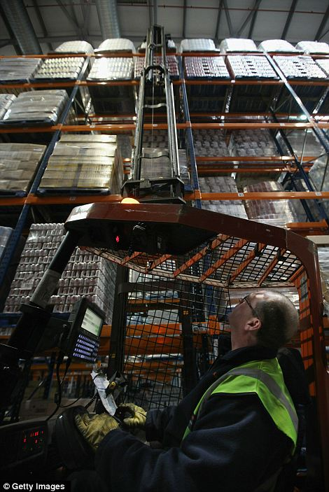Sweet tooth: Piles of chocolate selection boxes are readied for delivery to Sainsbury's stores