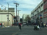 This is what Christmas Day looked like this year for thousands of homeless people in dark and dingy Skid Row - the underbelly of Downtown Los Angeles