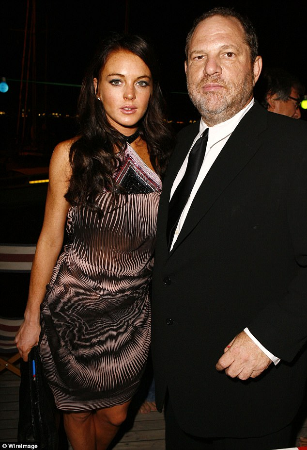 Defender: Lindsay, pictured with Weinstein at the Venice Film Festival in 2006, said that his wife Georgina Chapman should have stayed by his side amid the scandal