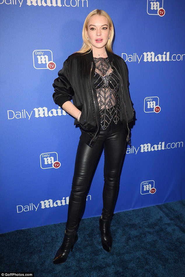 Tax troubles: Lindsay Lohan, 31, pictured at the Daily Mail's holiday party in NYC this month, is launching a probe into why she's behind more than $100,000 on taxes to the U.S. government