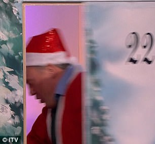 Playing the part: He was excitedly ho-ho-ho-ing off the Loose Women during a guest appearance.