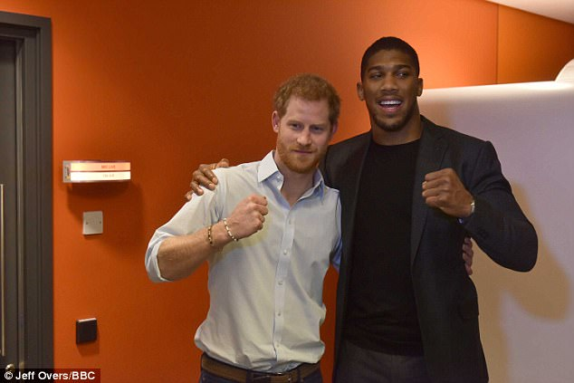 Prince Harry (left) requested that Anthony Joshua (right) was interviewed on the snow and the boxer wrote online: 'Need a best man?'