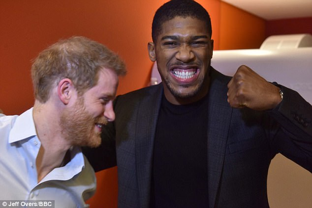 Boxing champion Anthony Joshua (pictured with Prince Harry) was also interviewed this morning