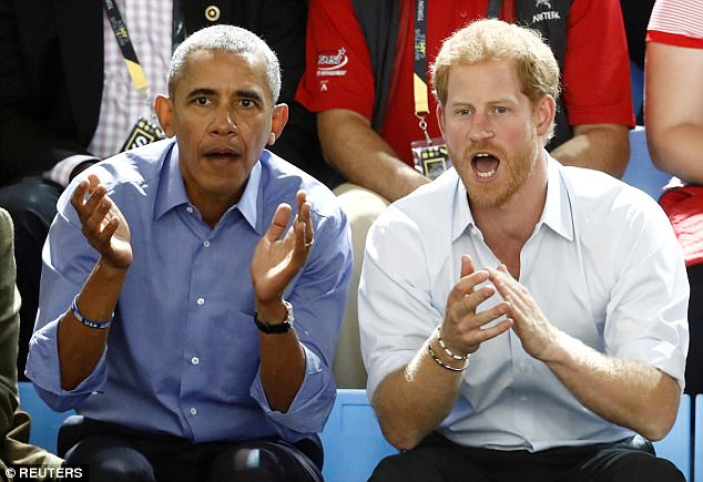 Prince Harry (pictured with Obama during the Invictus Games in September) asked him if he preferred the Good Wife or Suits