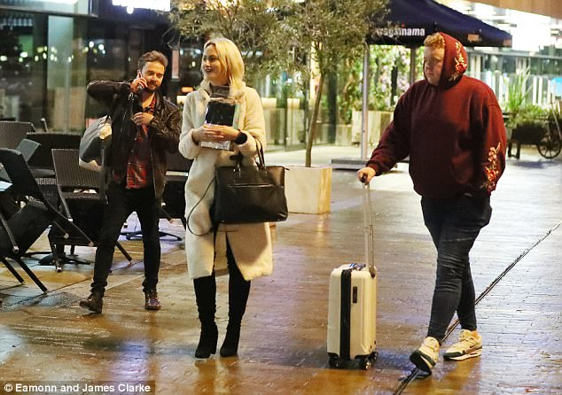 Gentleman: Jack's co-star Colson Smith, who plays Craig Tinker on the soap, was seen carrying Hanni's suitcase back to their hotel