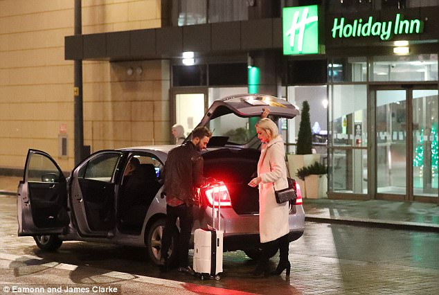Cosy: The couple were seen leaving their taxi after arriving back at their hotel after the festive gathering in The Botanist Bar