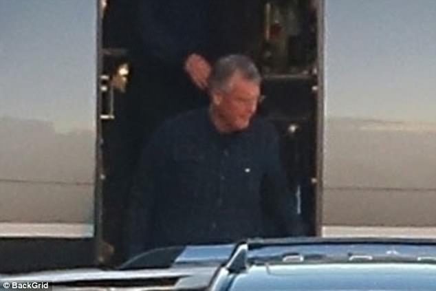 Family outing: Taylor's father Scott, 65, was seen deboarding the aircraft as well