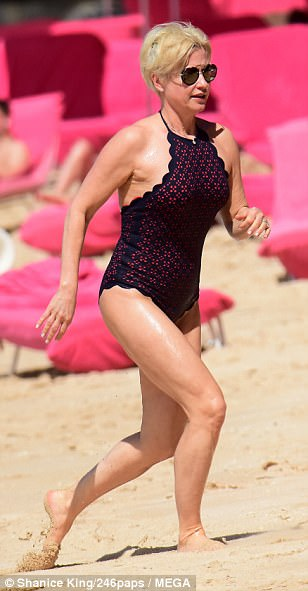 Sun-soaked: Her sun-soaked display comes after she revealed she overhauled her lifestyle after seeing what she felt were unflattering bikini pap shots - even though she still looked incredible