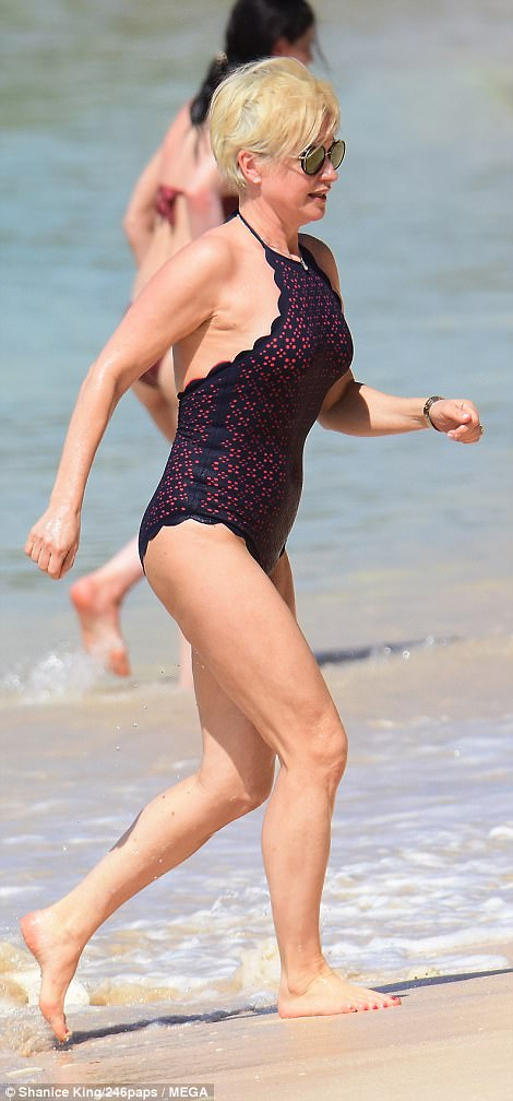 Soaking up the sun: Emma Forbes, 52, was back to her figure-flaunting tricks as she slipped into a slinky swimsuit while soaking up some winter sun in Barbados on Thursday