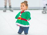 Harmonie-Rose Allen looked festive in a Christmas sweater as she skated on a synthetic ice rink with her family at at the Avon Valley Adventure and Wildlife Park in Keynsham, Somerset