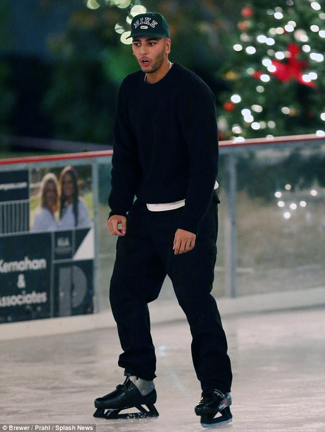 Hockey fan? Younes seemed not to be as chilly as his partner, and donned only a black crew neck sweater, ball cap and dark trousers for the sporting endeavor