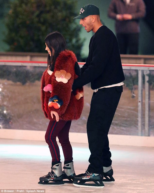 Nice guy: While Kourtney looked to be having some trouble navigating her way along, Younes looked quite comfortable on his skates, and even steadied his lady love by her waist several times