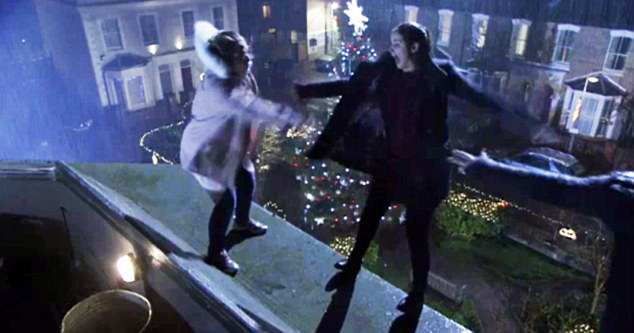 Troubling scenes: On Christmas Day, suicidal Max Branning (Jake Wood) was seen being talked away from the roof of the Queen Vic by his desperate daughters Abi (Lorna Fitzgerald) and Lauren (Jacqueline Jossa) - who ended up falling themselves